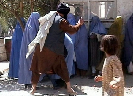 Facts about Afghanistan - Taliban beating woman for discovering her burqa in public